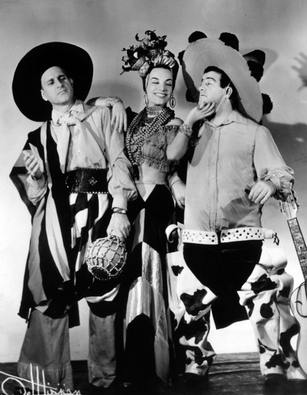 Abbott and Costello in a scene from one of their movies, with Carmen Miranda