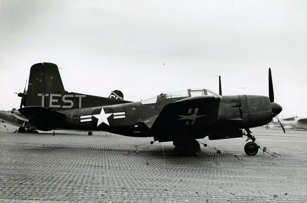 Douglas fighter plane next to runway at NAS