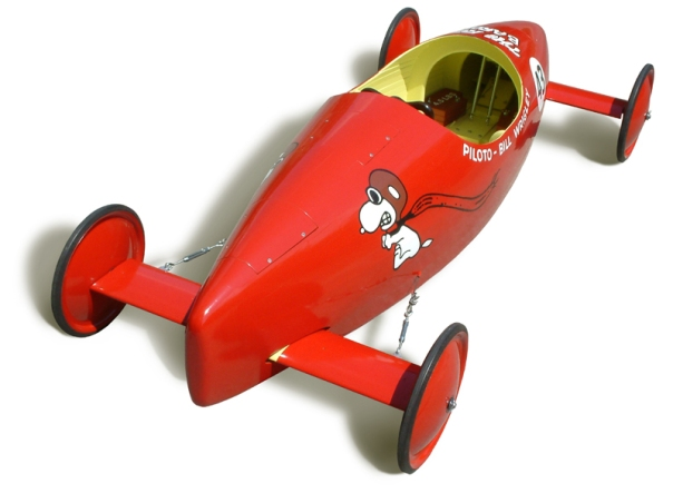 A  sleek soap box derby racing car like the one my uncles gave me