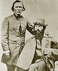 Fremont, at right, early in his career, posing with the famous scout Kit Carson