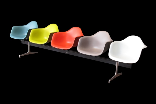 Eames chairs likely to be found in any cafeteria or airport lounge