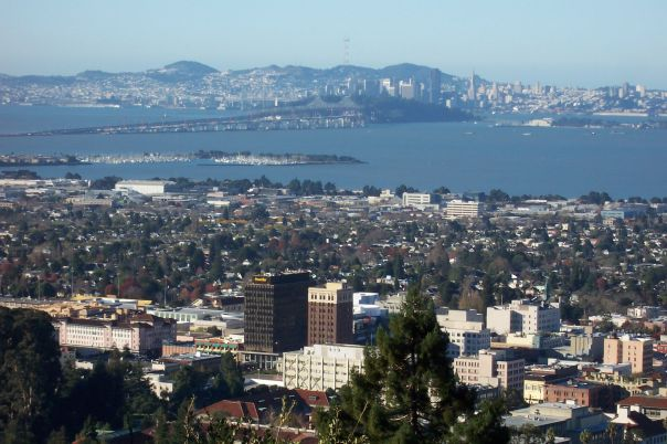 Berkeley looking west toward the Bay, with the tall buildings of the commercial shopping district in foreground